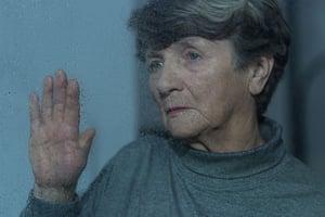 Portrait of elder woman experiencing depression