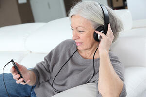 Senior woman listening to music with headphones-1