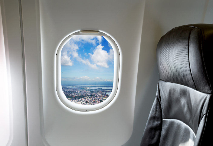 Beautiful landscape through aircraft window onto jet engine