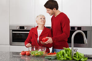 Grandma and granson enjoy cooking together