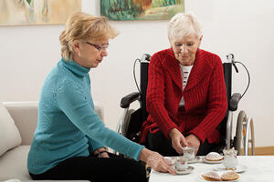 Two elder women drinking coffee and spending time together