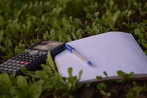 budgeting notebook, pen, and calculator