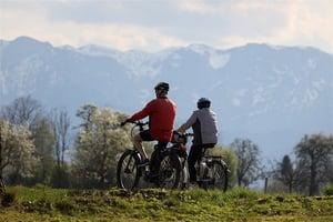 older couple biking together outdoors