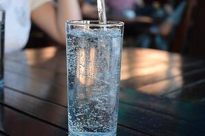 pouring water into a glass-hydration