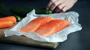 salmon filets on cutting board