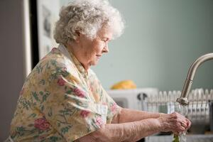 older woman washing dishes