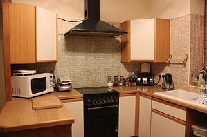 kitchen with tidy cords behind appliances