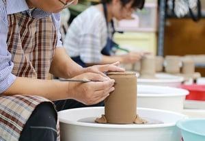 senior man practicing pottery