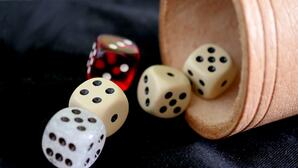yahtzee five dice and cup