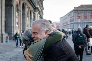 friends hugging in public