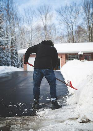 Clearing snow and ice from driveway