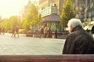 older man sitting alone on bench