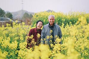 happy older couple in field outdoors