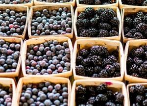 blueberries and blackberries in baskets