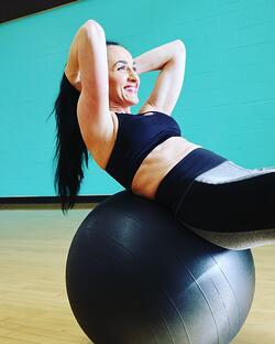 woman doing ab workout on exercise ball