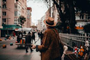 man-in-brown-jacket-and-brown-hat-standing-on-sidewalk-with-4031864