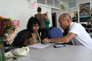 older gentleman mentoring turoring younger student