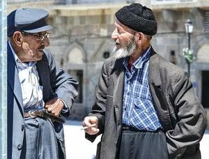 older man smoking cigarette outside