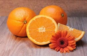 oranges, orange slices on table