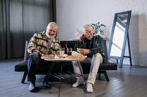 older male friends enjoying time together over a meal