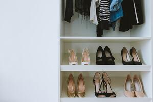 shelf of shoes in closet