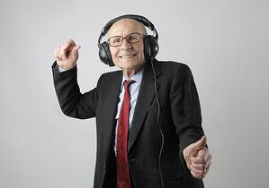 Older man dancing to music with headphones