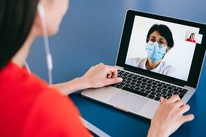 Woman speaking with doctor on video call