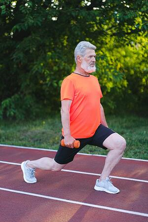 older adult doing lunge exercise