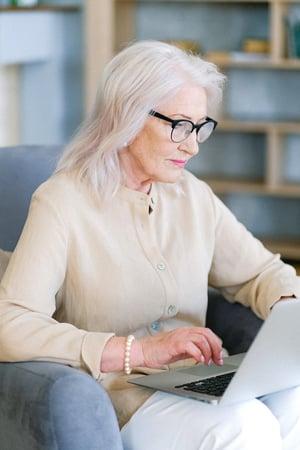 Retiree woman working on laptop