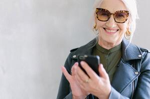 Senior woman on mobile phone with sunglasses