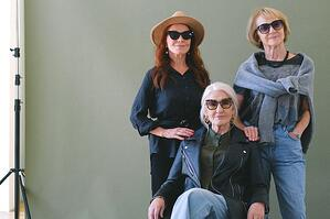 three older women posing together with sunglasses