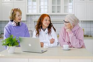 3 older woman spending time together in kitchen