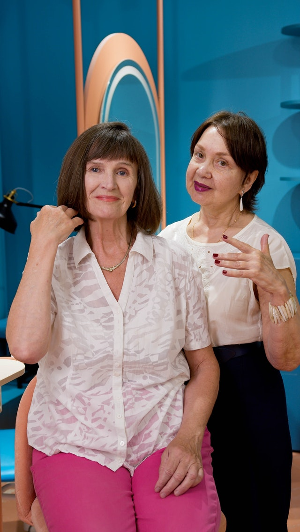 women discussing haircut at salon