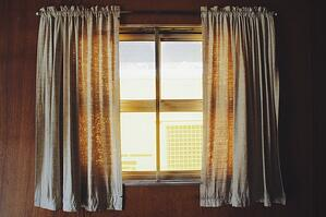 bright window with curtains to reduce glare