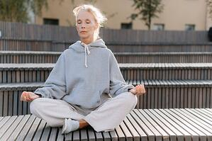 older woman meditation outdoors