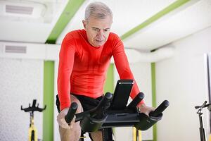 man participating in spin class