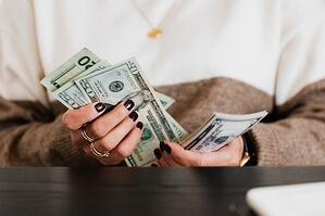 older woman counting money budget
