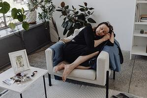 older woman fallen asleep on armchair during the day