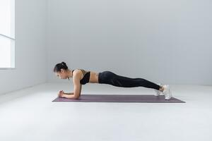 Foream plank exercise on yoga mat