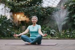 older woman meditating alone