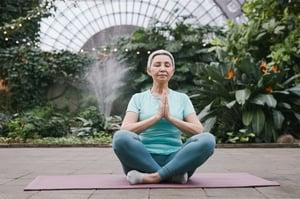 older woman sitting alone, yoga