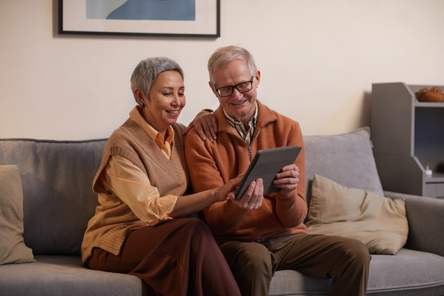 older couple participating in virtual tour on tablet