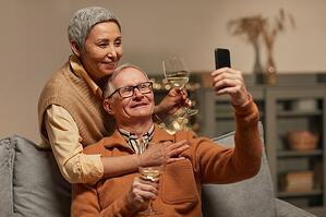 older couple on video call with their children