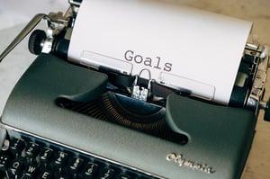 goals being created on typewriter