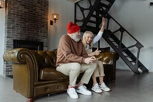 older couple playing videogames together indoors