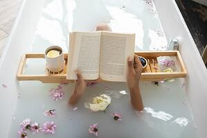 reading peacefully in evening bath
