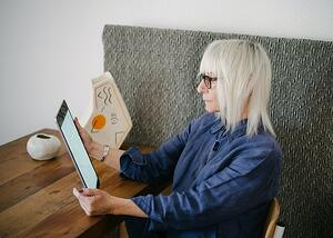 woman using tablet at the table