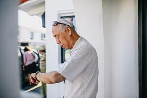 retired man checking watch