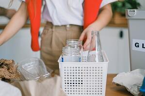 cleaning the kitchen glass bottles and food containers
