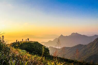 photo-of-people-standing-on-top-of-mountain-near-grasses-733162
